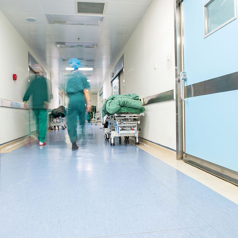 Image of nurses in a walking away in a hall